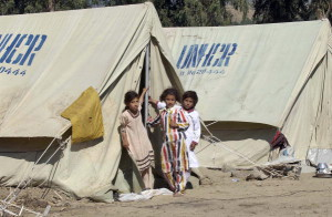 Girls pictured today in Bessian, Jammu and Kashmir, Pakistan at a tent city set up by the Office of the United Nations High Commissioner for Refugees (UNHCR) for some 300 families or 1,600 people.  Up to 10,000 people are expected to arrive at this tent city soon due to the on-coming winter.